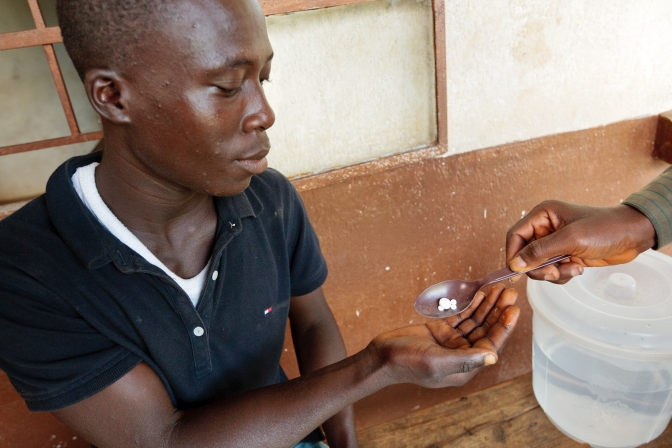 Patient Prince Marah, 24, Alex Lamin Kallon, community drug distributor