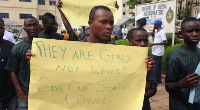 Men March Against Child Marriage in Liberia