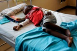 A young boy recovering from malaria. See full story