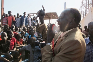 Michael Makuei Lueth, South Sudan's Minister of Information, addresses civilians outside a compound of the UN Mission in South Sudan (UNMISS). Juba, South Sudan UN Photo/Rolla Hinedi