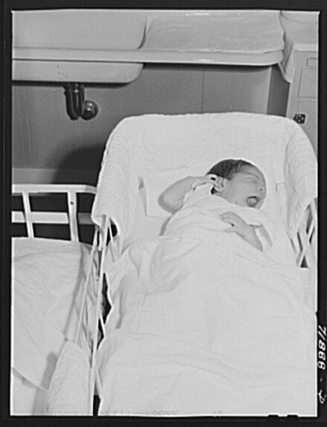 Baby in the nursey at the Cairns General Hospital at the FSA (Farm Security Administration) farm workers' community. Eleven Mile Corner, Arizona