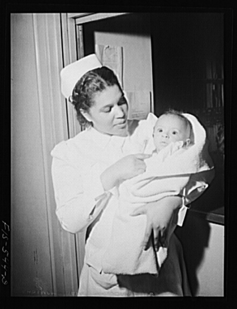 Chicago, Illinois. Provident Hospital. Miss Irene Hill, nurse technician, taking baby to be x-rayed. Jack Delano