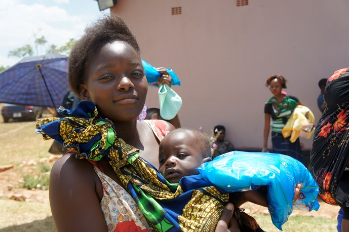Mother picking up an insecticide treated bed net
