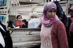 Al Qsair, Syria. Syrian women and children are seen as they are