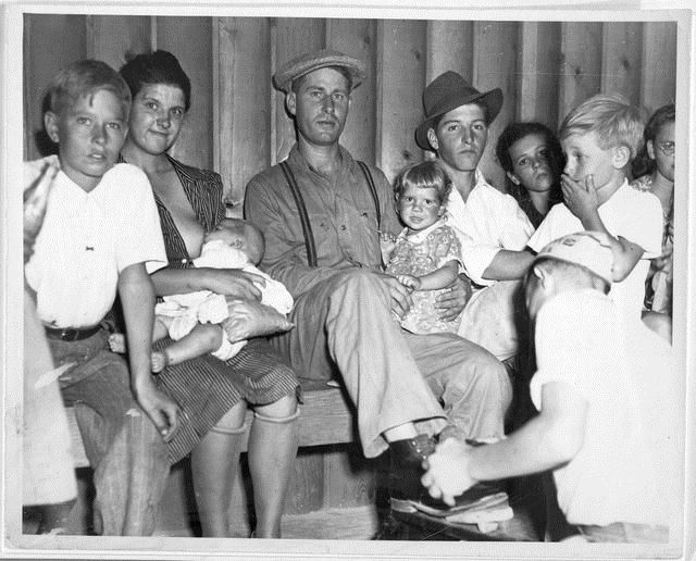 """a) Part of Social Hour audience at Shafter Camp (handwritten on reverse); b) Todd's favorite picture of an """"Okie Family"""" in Shafter F.S.A. Camp. Nursing babies was the usual thing at camp """"Socials."""" (typed and attached to reverse)"""