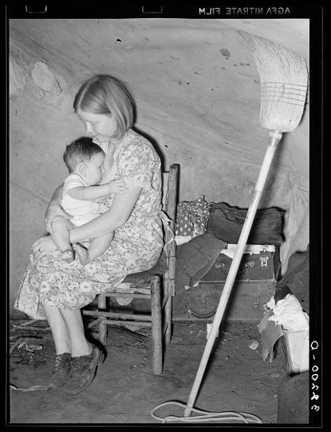 Migrant mother and child in tent home. Harlingen, Texas; Lee, Russell, 1903-1986, photographer; LC-USF34- 032200-D
