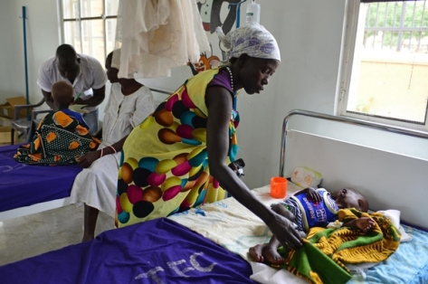 "Country: South Sudan Year: 2014 Photographer: Christine Nesbitt title / Job name:  caption:      On 11 August, Nyabol Hion holds her 2-year-old daughter, Nyanmot Lam, at Al Sabbah Paediatric Hospital in Juba, the capital. ""I travelled here by boat with my husband's brother,"" says Ms. Hion. ""My three other children stayed with my husband in Walyar in Unity State."" Her home was destroyed during the conflict, and she lived for a while in the bush after fleeing the fighting. Nyanmot's illness began in April 2014, but she has been in hospital for only three days, receiving therapeutic milk every two hours for her malnutrition, as well as antibiotics to treat her diarrhoea and vomiting. ""Nyanmot is not the only sick child I've seen,"" say Ms. Hion. ""Many children are sick, and many are passing away."" After Nyanmot's treatment, they will return to Walyar. ""My wish is for a good life and peace,"" says Ms. Hion, who advises mothers that ""if your child is sick, take the child to the hospital."" In early August 2014 in South Sudan, 1.1 million people have been displaced since resurgent conflict erupted in mid-December 2013. An estimated 588,222 of the displaced are children. Some 434,000 people have also sought refuge in neighbouring countries. UNICEF has appealed for US$151.7 million to cover emergency responses across the vital areas of nutrition; health; water, sanitation and hygiene; protection; education; multi-sector refugee response; and cholera response. By 5 August, 62 per cent remained unfunded."