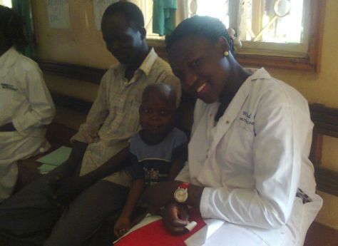 Kenneth and his father after he was discharged from the Nutrition unit in Lira district, Uganda