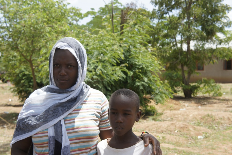 Brother and sister at male circumcision appointment in Tanzania
