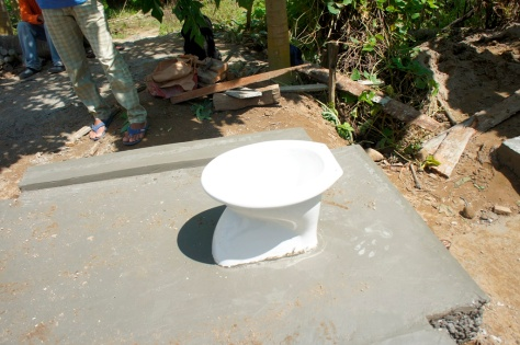 The household pit latrine will no longer be used. An outside bathroom is being built with a septic system in rural Dulag, Philippines.
