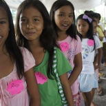 Girls ar a World Vision Christmas event in the Philippines