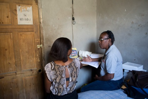 Roselaure Isidor provides counseling to a commercial sex workers at a brothel.