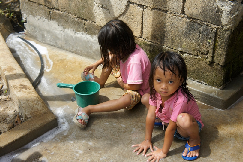 Girls in the Philippines playing in water