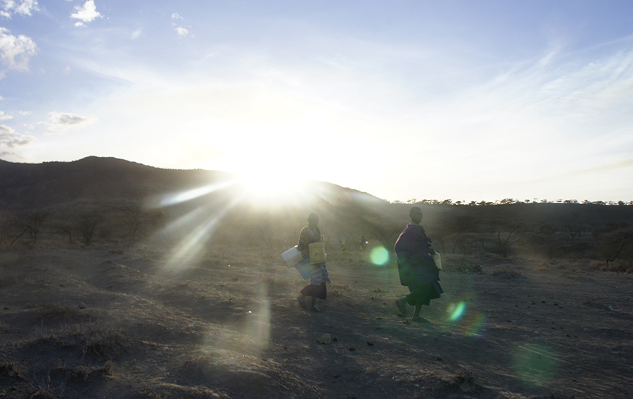 Maasai girls going to get water