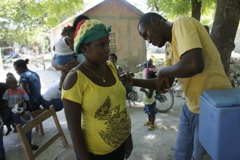 Expectant women receiving tetanus vaccine in Deschappelles, Haiti.