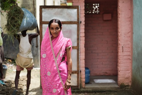 "Preeti, a married mother of two from Masnapur Village in India, told her in-laws and husband that if they didn't get a toilet, she'd go back to her parents who did. Her husband paid for a toilet through PSI's social enterprise. One of the most popular features of the toilets PSI is helping to construct in India is the small ""cubby shelf"" in upper right corner that lets women store sanitary supplies for menstruation."